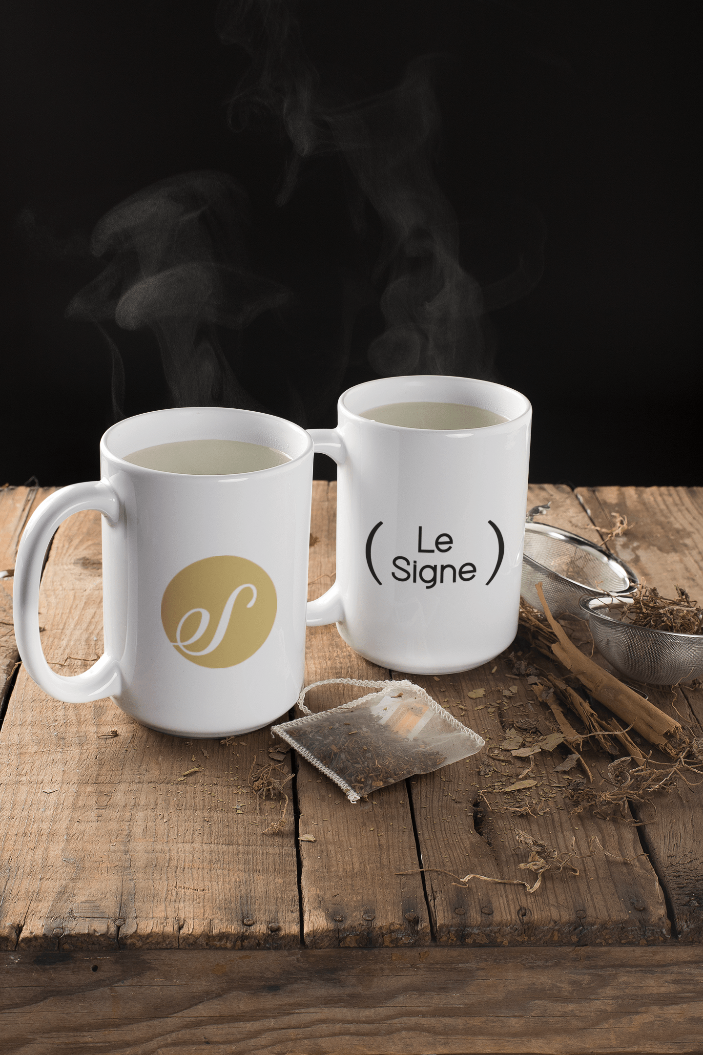 mockup-of-two-mugs-with-steaming-water-surrounded-by-tea-leaves-23902